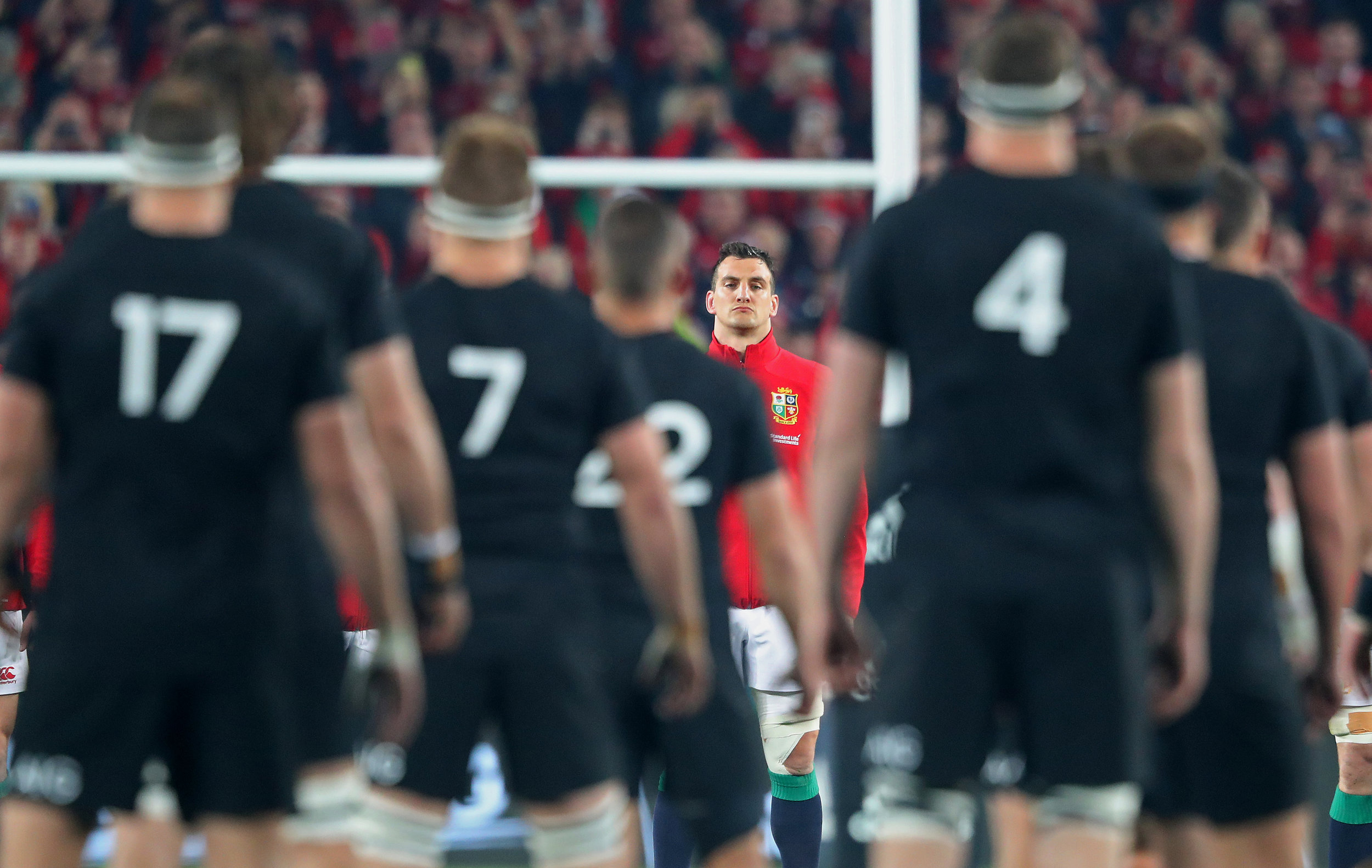 The British & Irish Lions captain Sam Warburton stares down the New Zealand All Blacks, during their traditional pre-match Haka at Eden Park Stadium, Auckland, before the deciding third Test match.Photo by Marc Aspland  08 July 2017