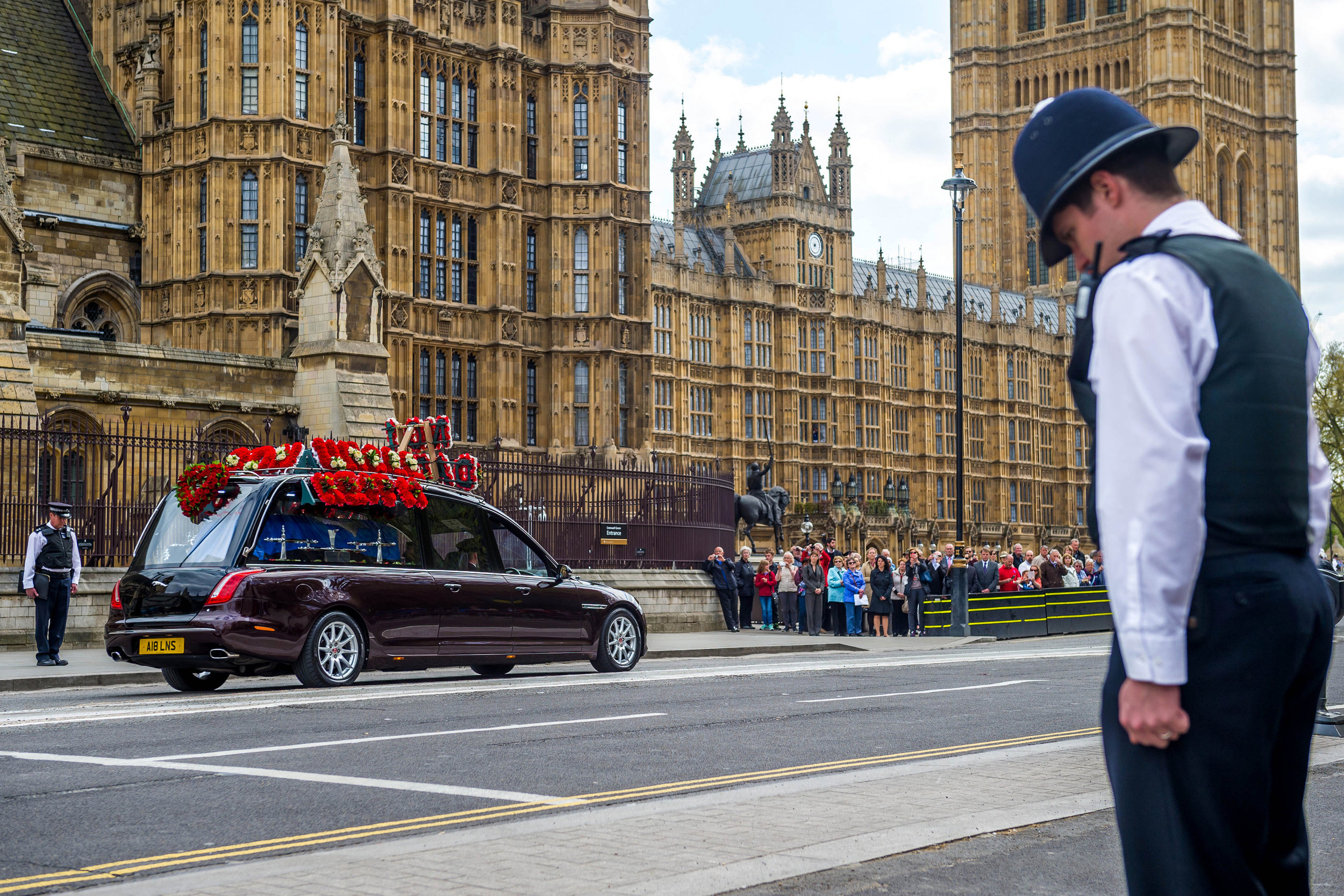 As a mark of respect officers of the Metropolitan Police bow their heads as PC Palmer's funeral cortege is driven out of the Chapel of St Mary Undercroft in the Palace of Westminster. PC Palmer was murdered by Khalid Masood during the terror attack on Westminster Bridge and the Houses of Parliament.Photo by Pete Maclaine  10 April 2017