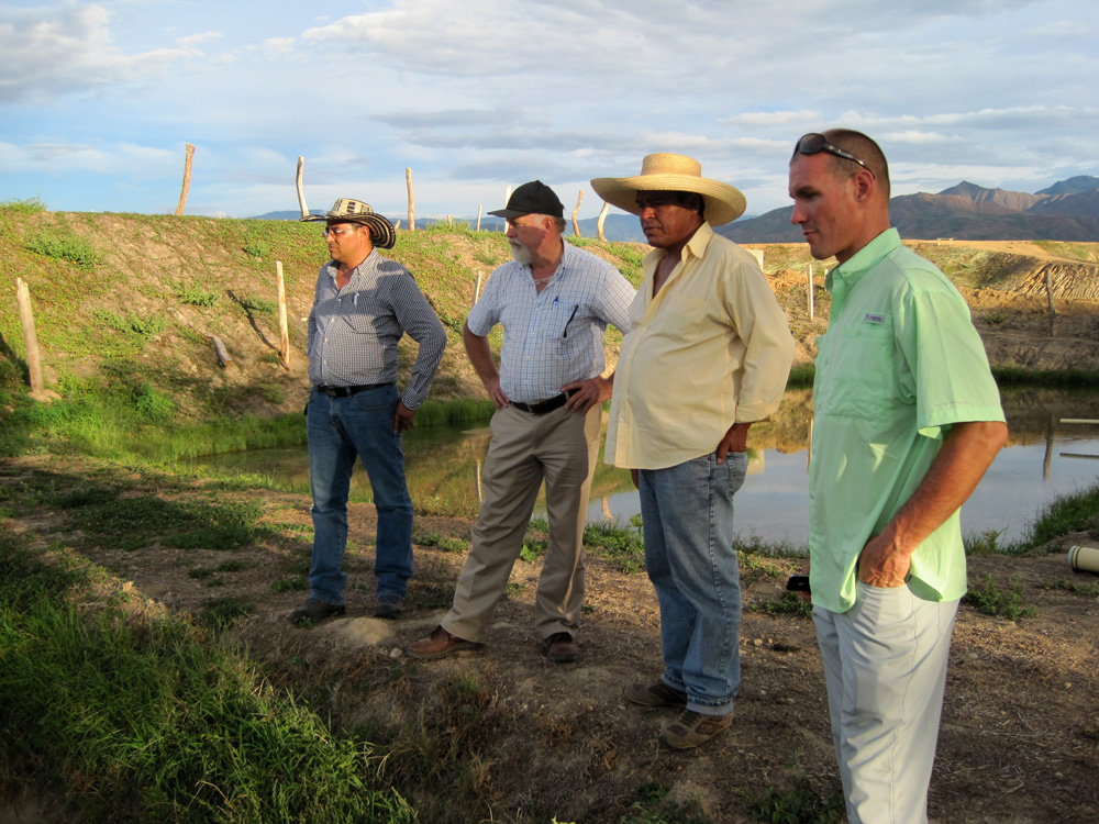 The Keeton Team in Colombia with a tilapia aquaculture farmer