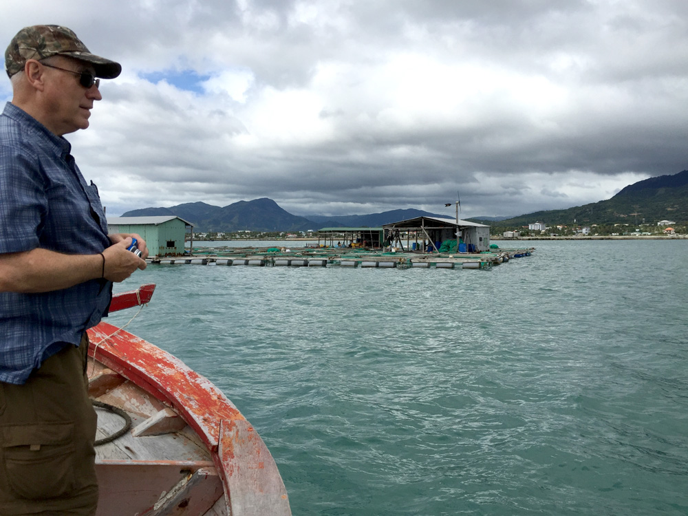 Founder Jim Keeton looking at the cage culture aquaculture environment in Vietnam