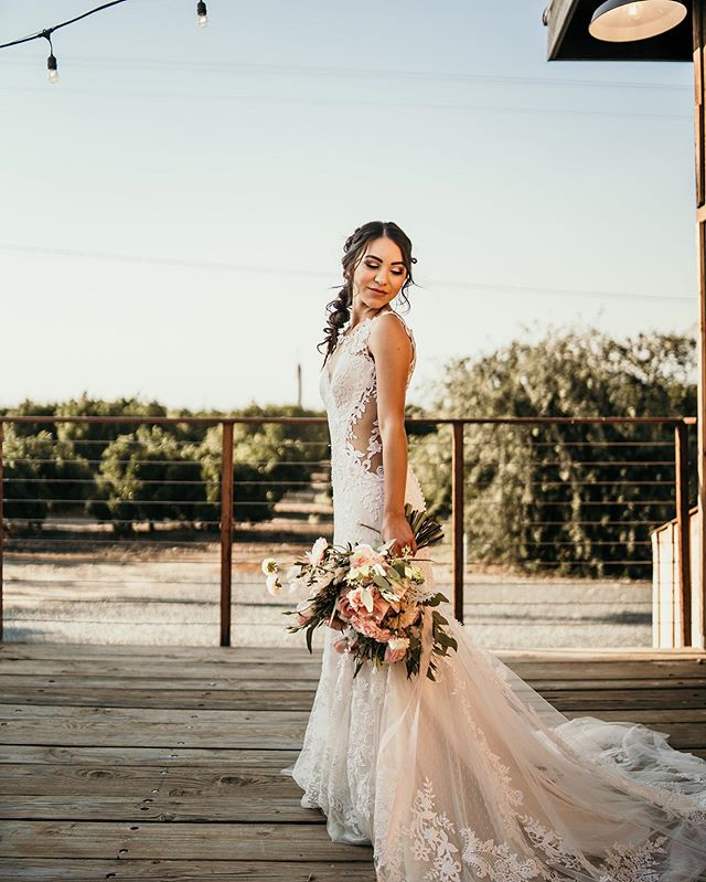 This view. That dress. Those florals. Our bride. All heart eyes! • • • • • • • Host: @photosbycatrease Florals: @rusticrootsfloraldesign Dress: @whatsupeurope Suit: @tux_n_tails Venue: @merrymanstation  Design: @onethreeevents Rentals: @sweetlifevintagerentals Hair: @just.hair.stuff Makeup: @lily_glam_ Calligraphy: @brushingbalti Models: @nissa_mariah7 + @flash_johnson13 Photos: @abbottphotoandfilm • • • • • • • • •  #weddingplanners #weddingdesign #centralcaliforniaweddings #visaliaweddings #exeterwedding #Californiawedding #citruswedding #orangeorchard  #dirtybootsandmessyhair #centralcaliforniawedding #centralvalleyvenue #indoorvenue #industralwedding