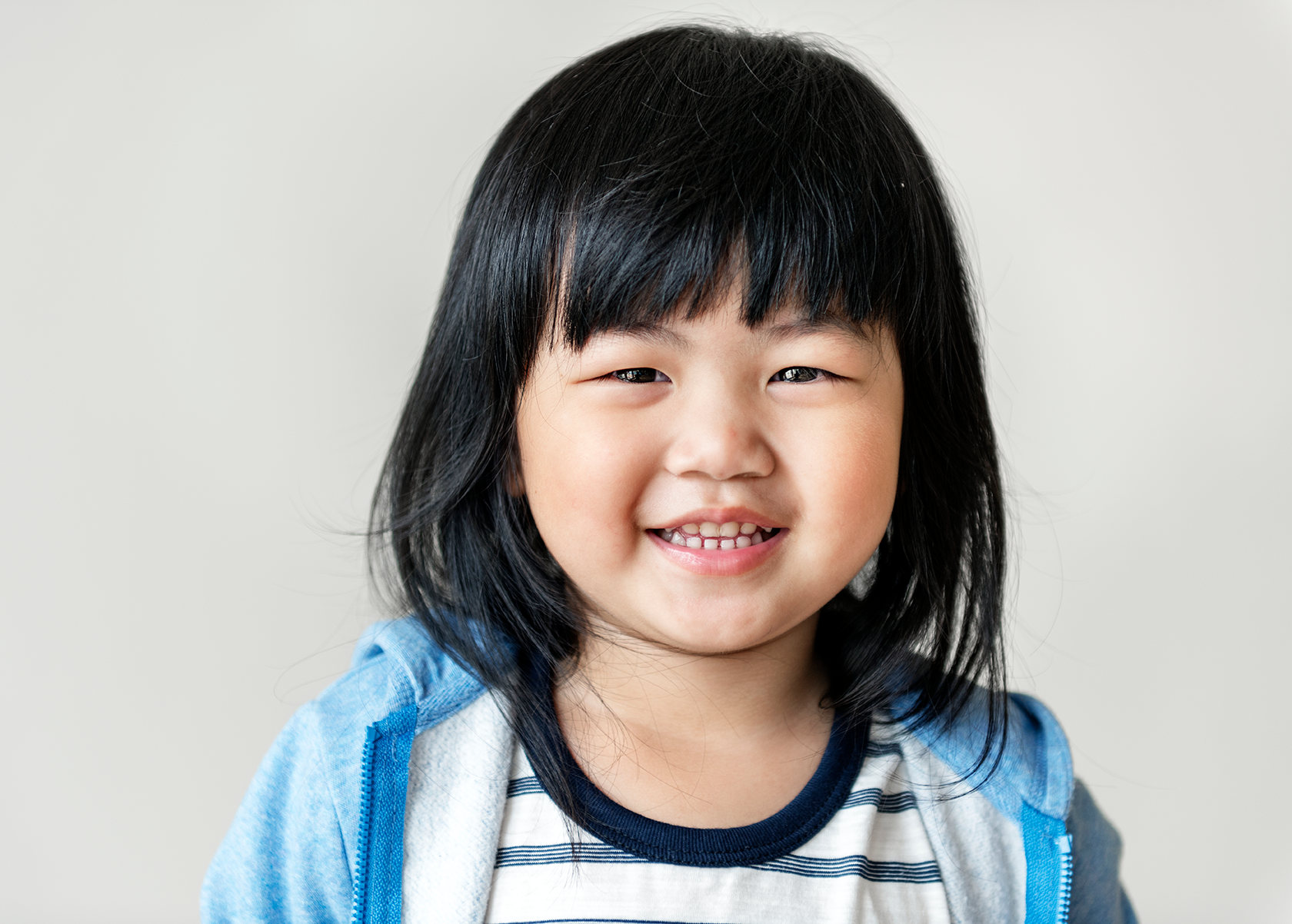 portrait-of-cheerful-asian-girl-PPGTVAU-2.png