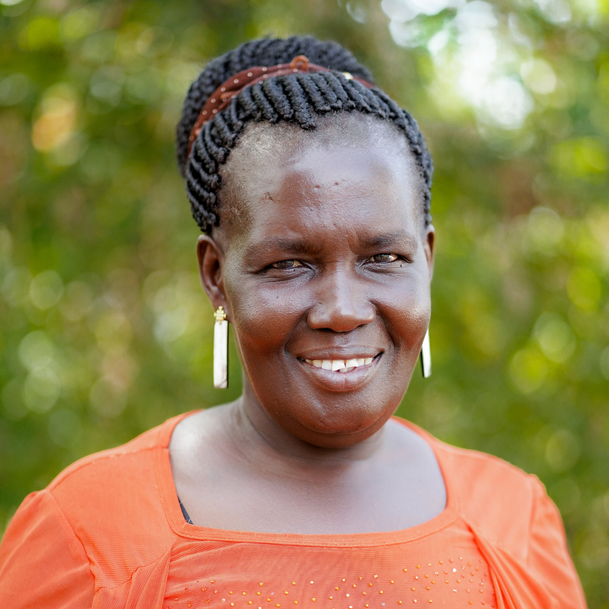 hella yangiprogram coordinator, sustainable livelihoods - Yangi hails from Northern Uganda and was forced to flee her home due to the ongoing conflict and war. After working for as a jewelry producer two years, she was promoted to a Supervisor position and enjoyed supporting her peers to improve their skills now Yangi works as the Program Coordinator and provides leadership for financial inclusion activities. Yangi primarily focuses on managing all saving groups records and ensures that the VSLA (Village Savings and Loan Association) database are complete and accurate.