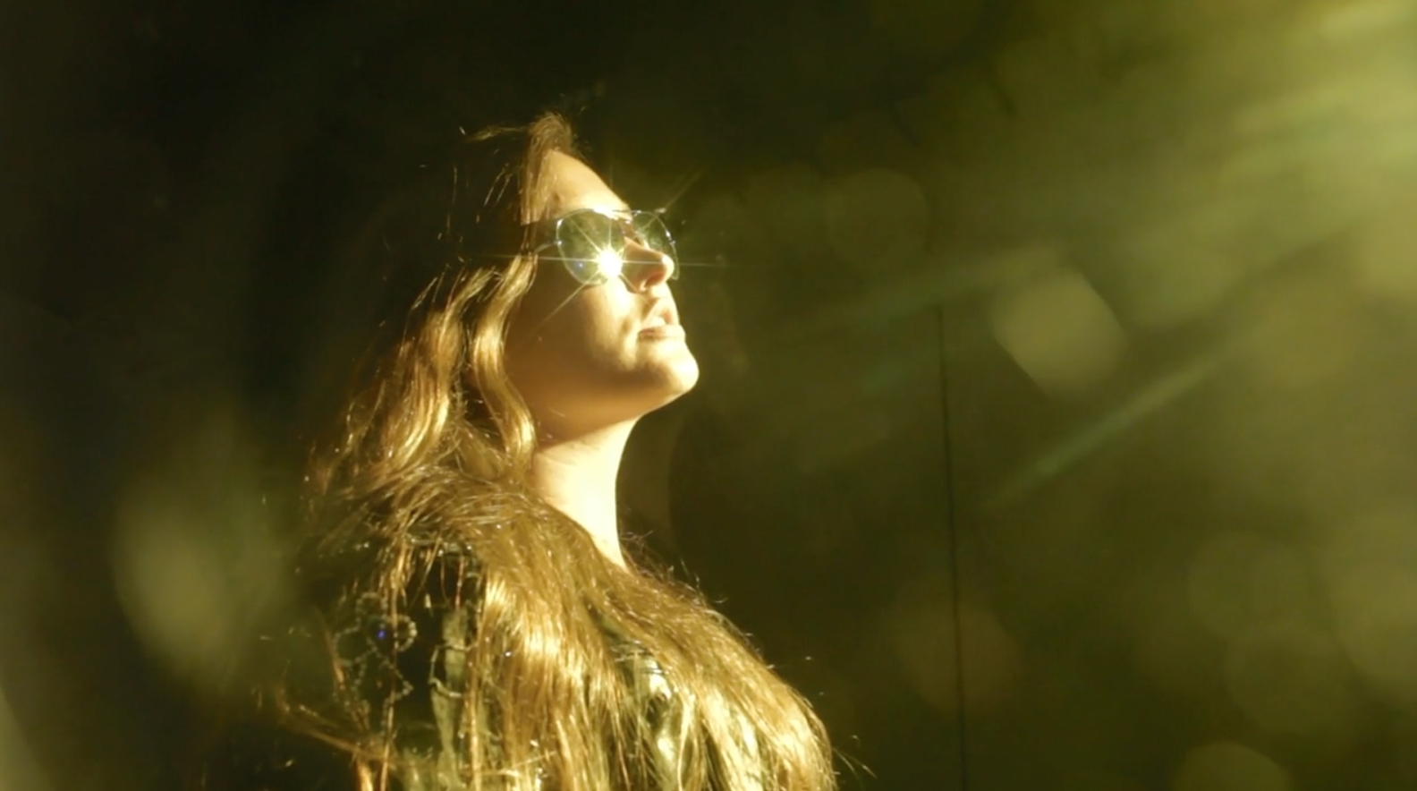 """Video Still from """"Shadow of a Woman"""", vocals and performance of Gold Dust Woman by Michelle Tompkins (pictured)."""