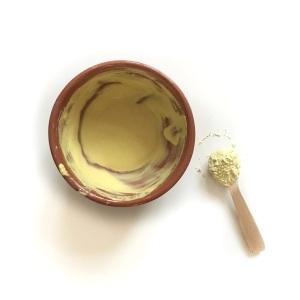 Thanaka powder mixed with water.