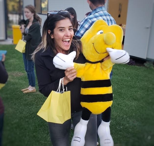 Dani with a bee plush doll.jpeg