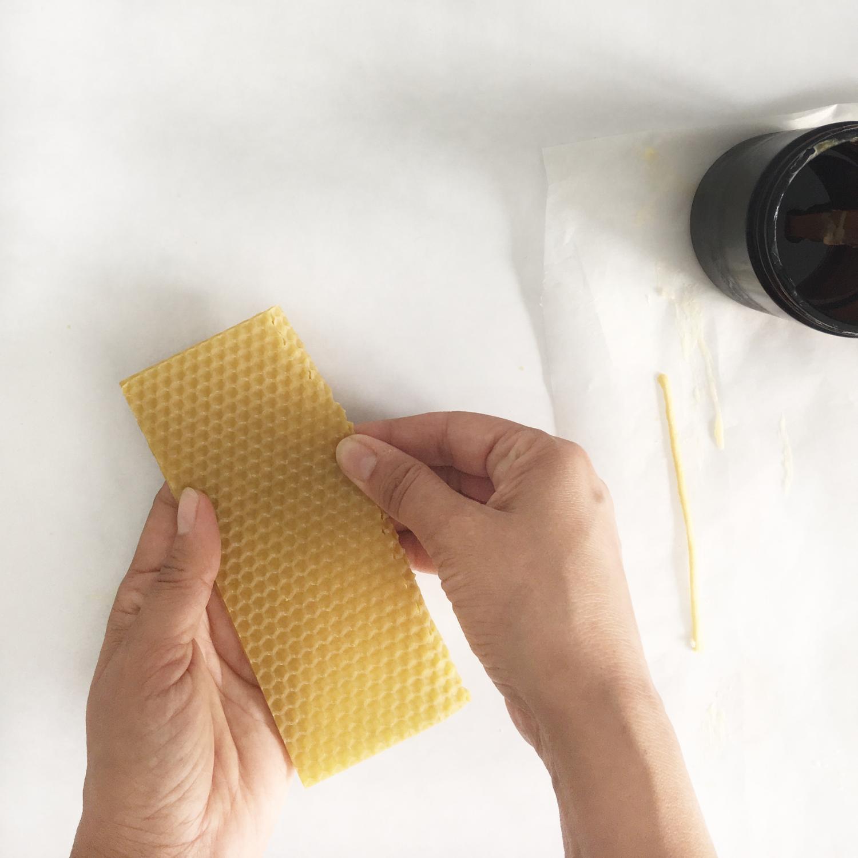 Fold or cut the wax sheet in half.