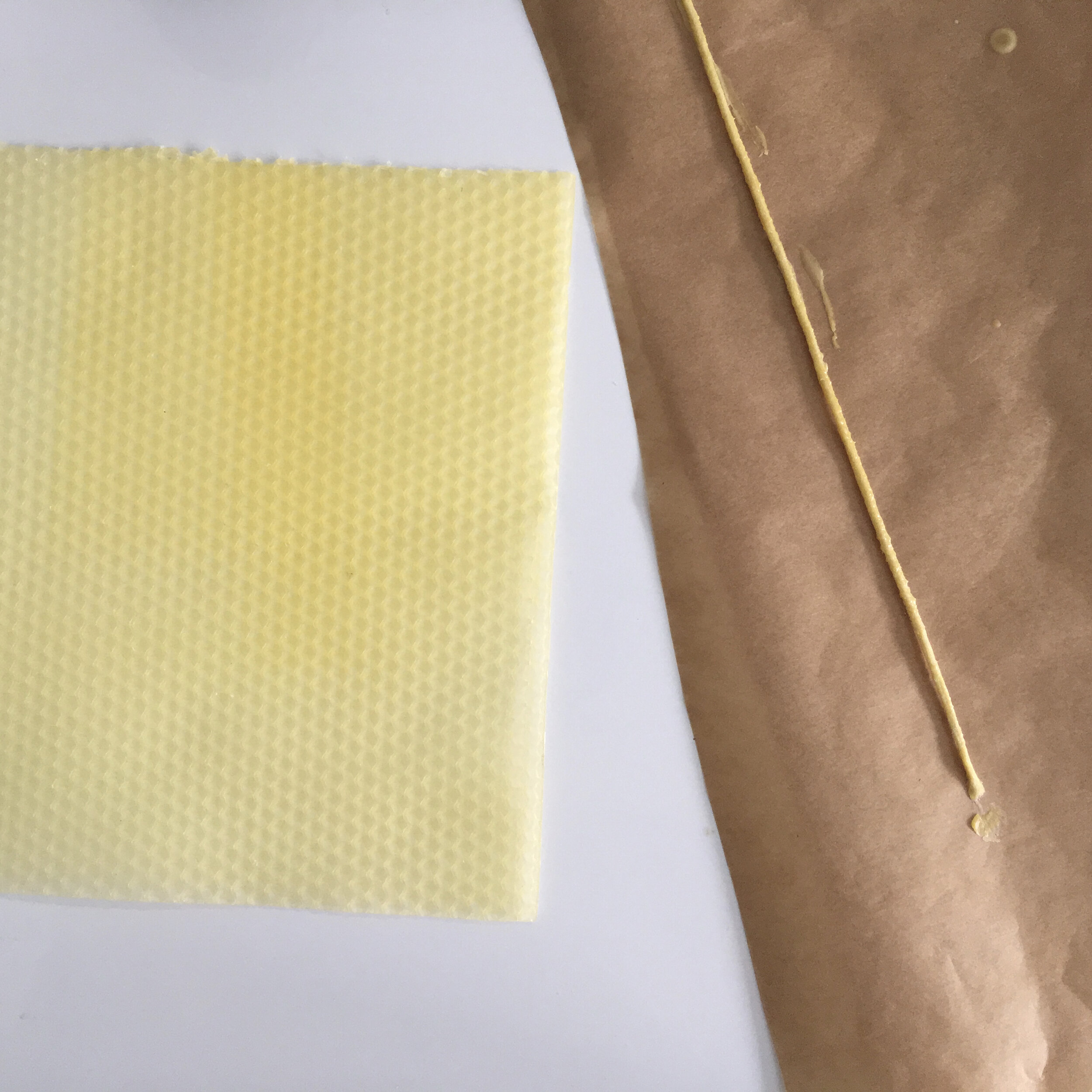 Dip the wick in wax, squeeze out any air and stretch onto some grease-proof paper.
