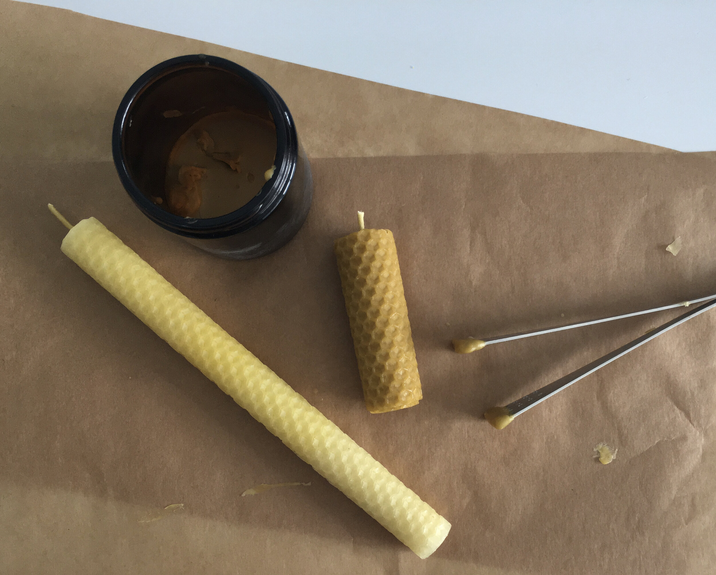 rolled beeswax candles on parchment paper