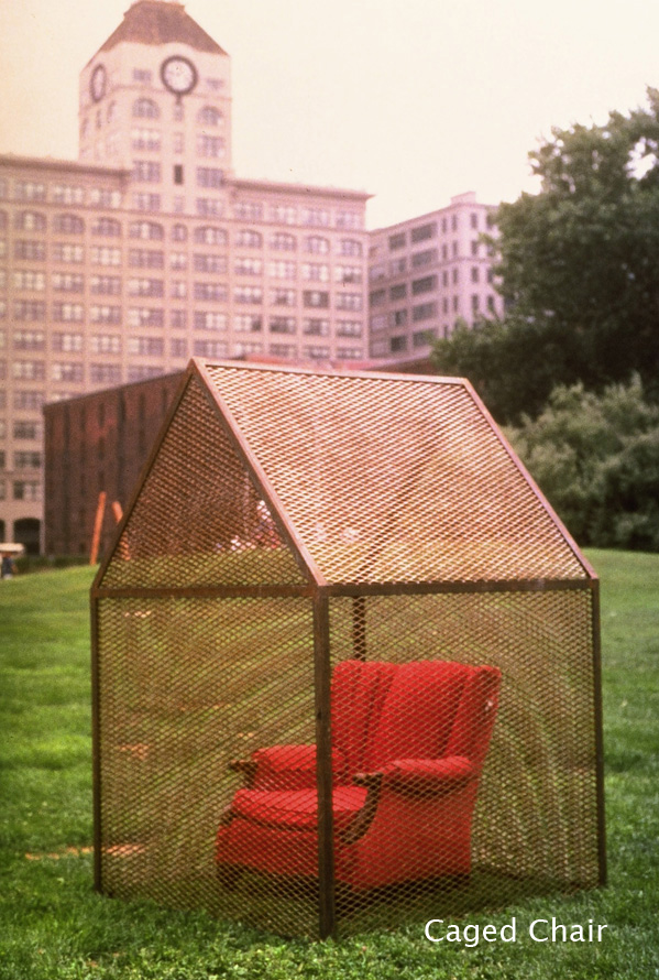 "Caged Chair - As described above, this is a hybrid piece which, when placed in a protected interior setting, appears static, but, when displayed in an unprotected exterior setting, ""performs"" in response to distressing weather. It consists of an old upholstered easy chair within a house-shaped cage made of welded steel mesh."