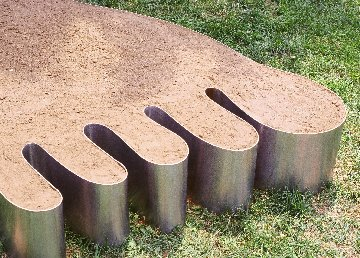 One Foot of Topsoil - Humorous visual puns give way to thought provoking commentary. The first foot of topsoil on earth is the most nutrient rich and productive.Material: Stainless Steel and Topsoil Approximate Dimensions: 9' x 4 1/2' x 12