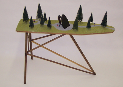 Flat Iron Park - Material: Iron, Ironing Board, and Model Figures & Trees.Dimensions: 3' Ht x13