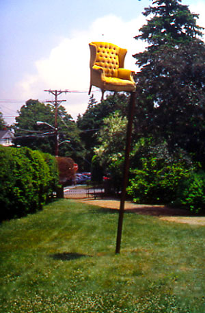 Chair in the Air - Placing an object of desire out of context and out of reach.Steel / Easy ChairApproximate Dimensions: 16' Ht. x 4' x 4' Installed - 1999Moses Kent HouseExeter, N.H.