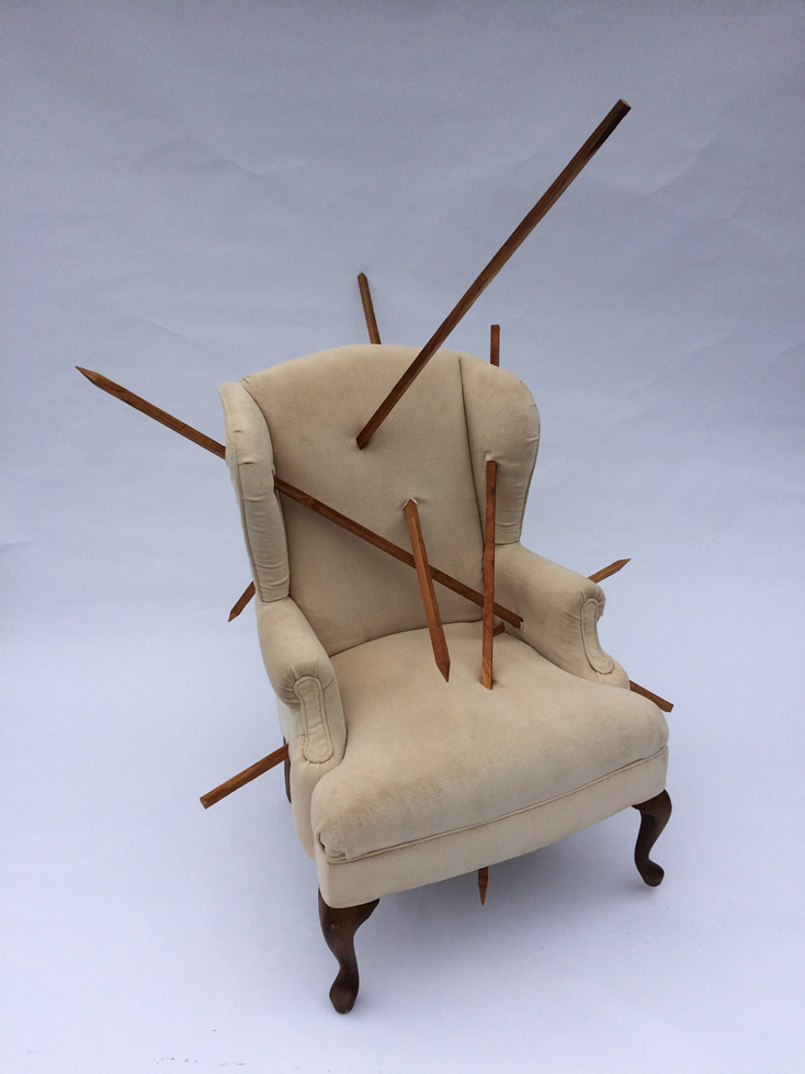 "Speared Chair - This piece consists of an old easy chair upholstered with worn ivory velvet. The body of the chair is pierced by long wood spears in numerous places. Among other images, the chair's distress recalls the martyrdom of Saint Sebastian, a favorite subject of Renaissance painters. Copyright Jamie Calderwood 2018 Materials: Wingback easy chair and wooden spearsDimensions: 46"" x 54"" x 59"" Ht."