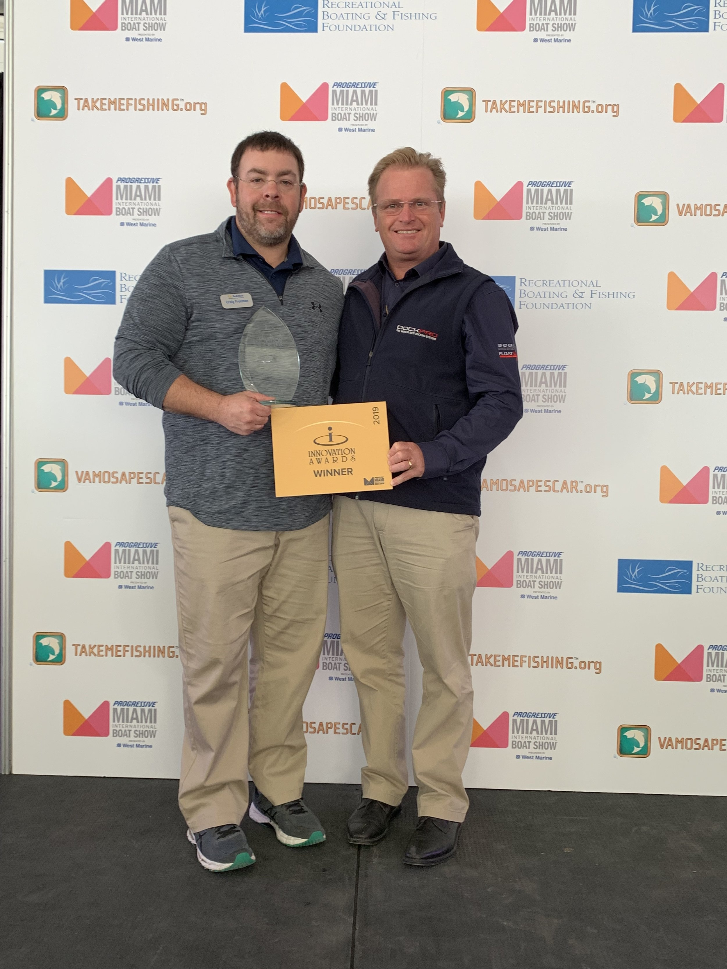 Solstice Docking Director of Sales Craig Freeman and SeaPen inventor Mark Barber accept the 2019 Miami Boat Show Innovation Award.