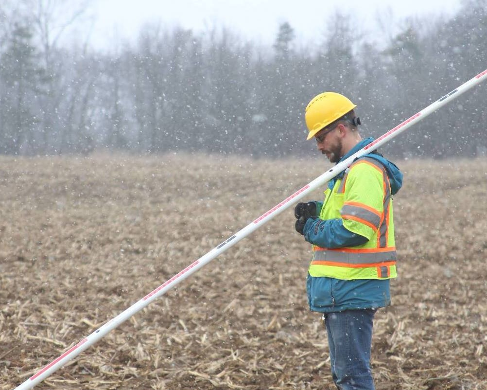 a katapult employee out in the field collecting pole data