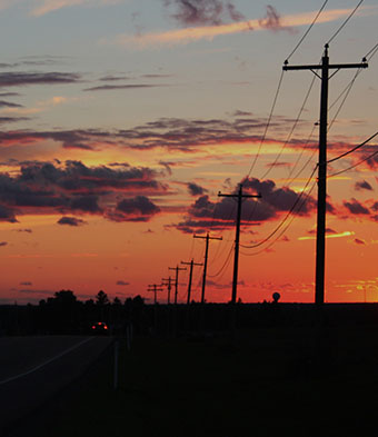 a scenic picture of telephone poles