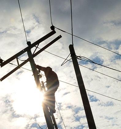 a technician servicing a telephone pole