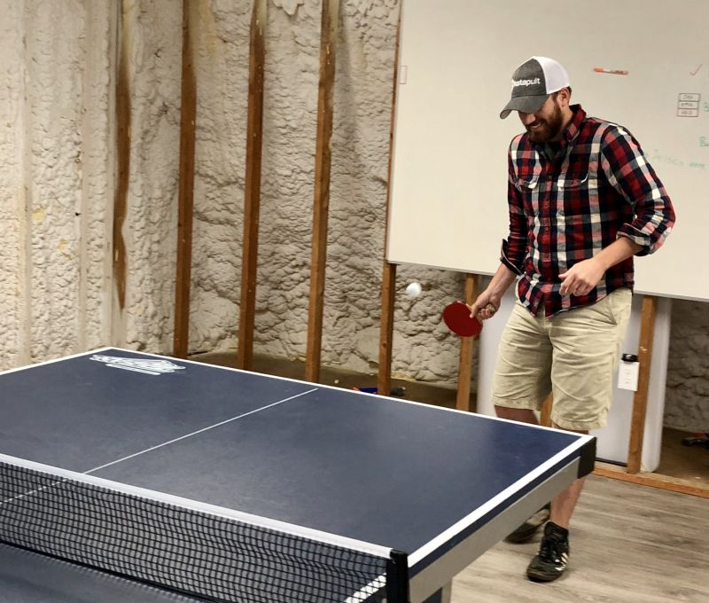 a katapult employee playing ping pong