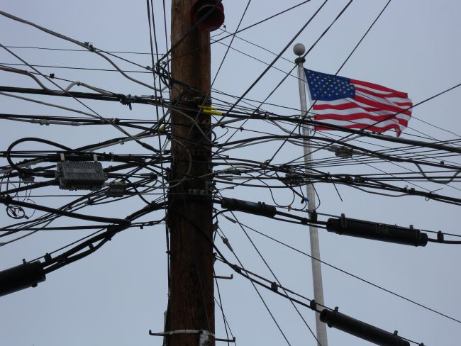 an extremely messy telephone pole