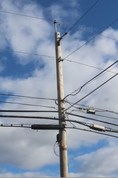 a photo of the comm space of a telephone pole