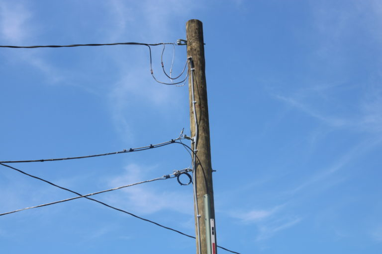 """a """"back shot"""" which displays the top of the pole and all of it's wires"""