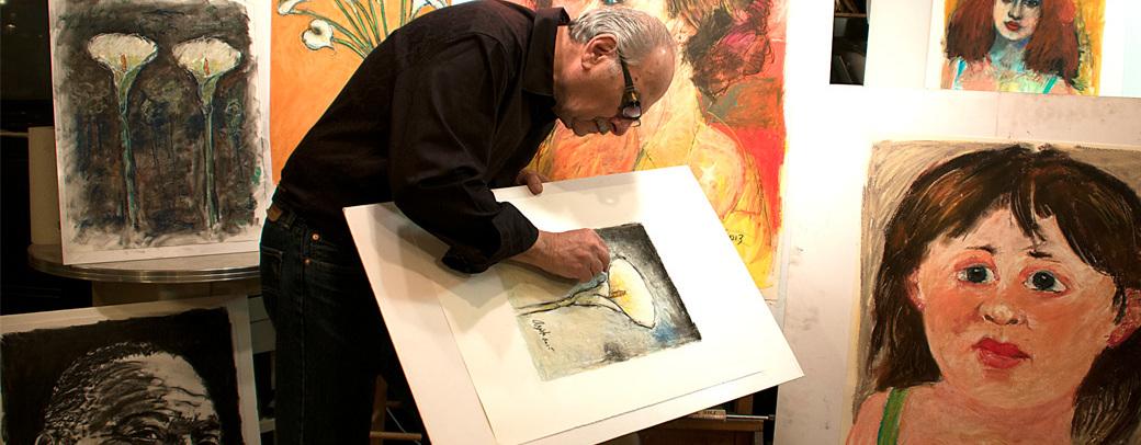 Frank Argento working in his art studio
