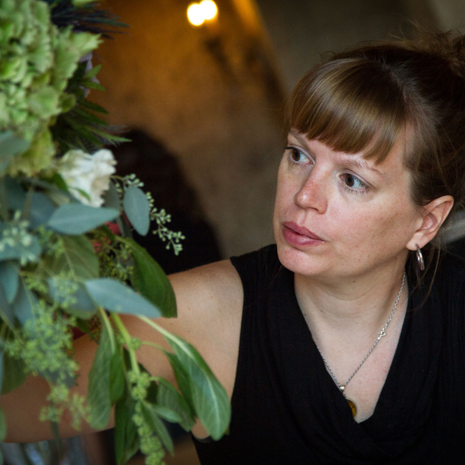 Adrienne - Designer - A fleurista since 2007; she started in the original location and is now a full time designer.
