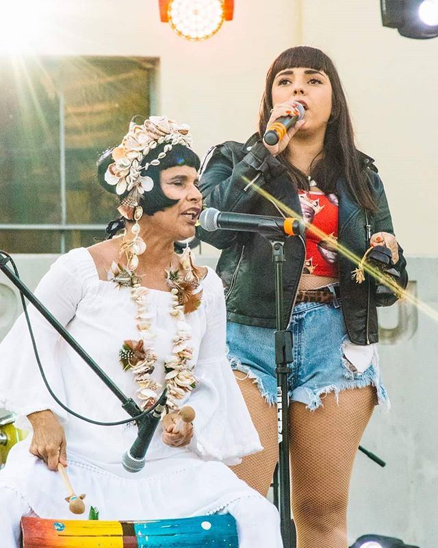That one time when @jarinademarco joined her beautiful mami on stage to sing indigenous #taino songs at #valleypride2019. I first saw these 2 together on both @semidivina's #missmodular radio show and also their beautiful @bese video. Go listen and follow! . . Photo by @salpytalian