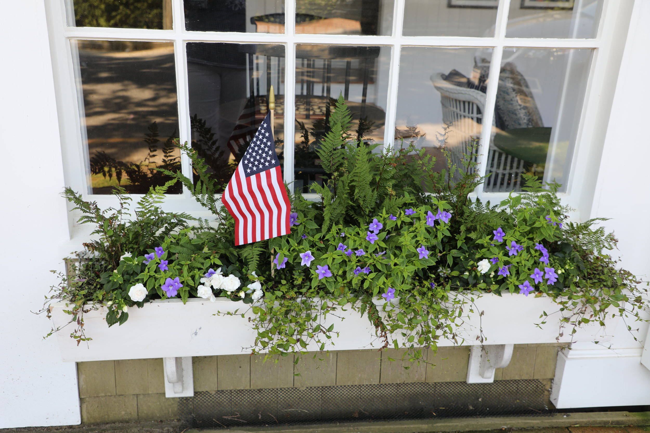 Beautiful window box made even more beautiful by the addition of our American flag!! Sconset. ©betsygibsondesign