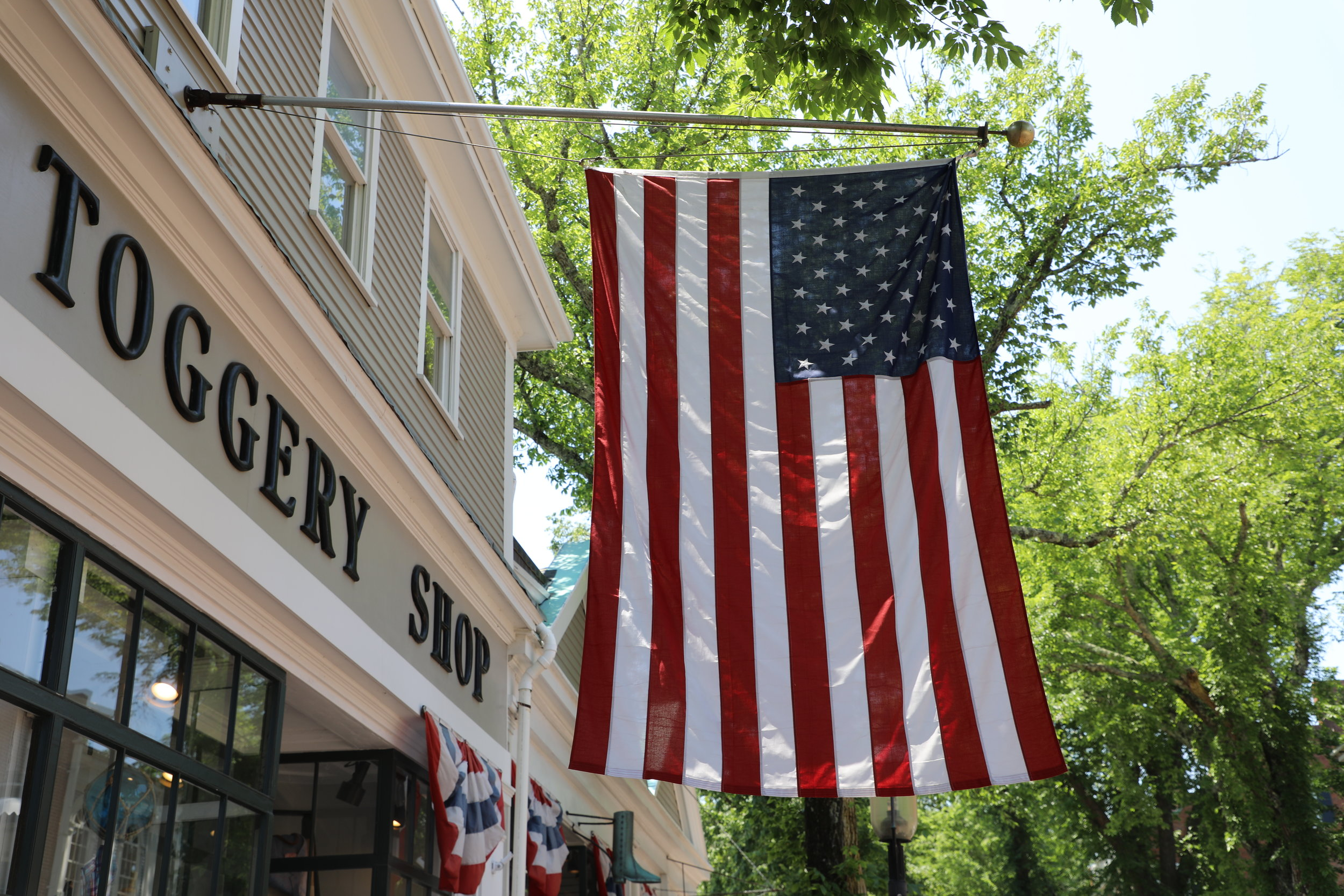 In town festivities. Let the celebration begin!!! The American Flag at Murray's. Main Street. ©betsygibsondesign
