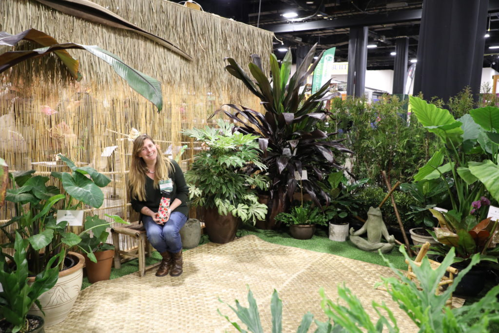 "Photo ©Betsy Gibson Design. Hannah Traggis of Mass Hort, sitting inside of ""The Golden Mean"" Garden Display, Boston Flower Show 2019"