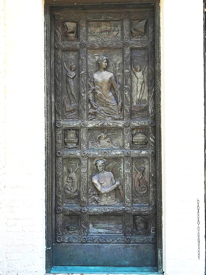 One of two bronze doors flanking the old entrance to the Mariners' Museum in Newport News, VA. Isn't this door fabulous? It's mate on the other side is equally as cool (photo below). The doors were commissioned by Archer M. Huntington, co-founder of the museum along with Homer L. Ferguson, back in the early 1930s. Herbert Adams, a renowned sculptor of the time, was the artist. Why Mr. Huntington did not commission his amazing wife, Anna Hyatt Huntington, to create the doors is a question I would love to ask…I suppose she could have been too busy with the Lions at Lions Bridge….? ©betsygibsondesign