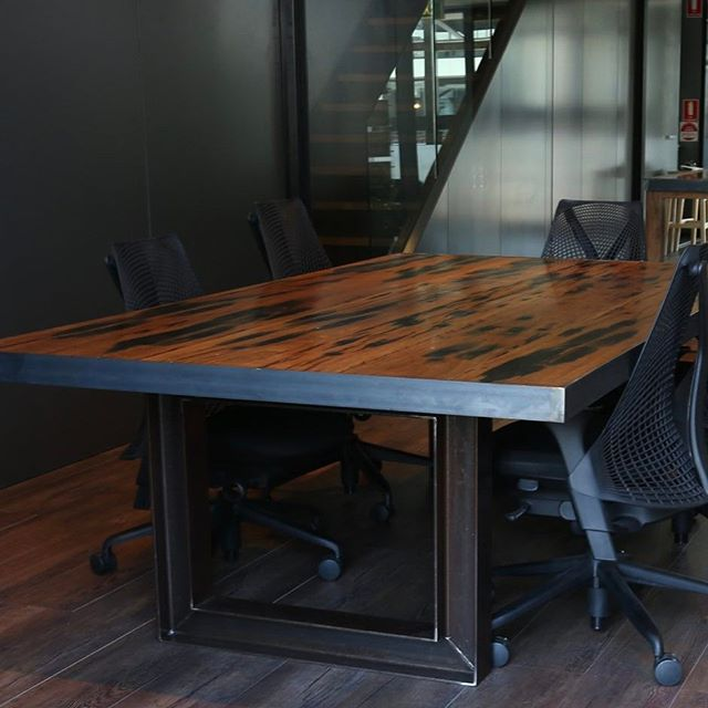 This is a recycled railway sleeper boardroom table with I-beam leg detail for our friends at Shift8