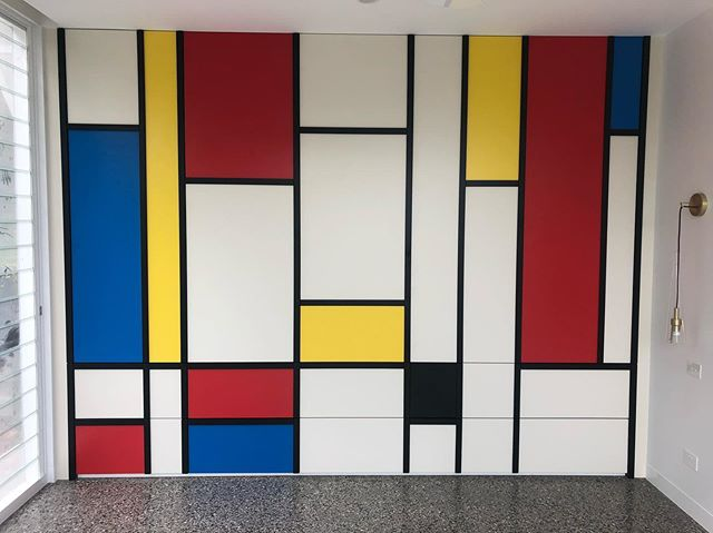 Abstract art in bedroom 2. Piet Mondrian inspired robe at Pine Ave. This and all else by the guys at @naileditkitchens is on point. #pietmondrian #mondrian #art #robe #joinery #wardrobe #design #architecture #nearlydone #polishedconcrete #bedroom #abstract
