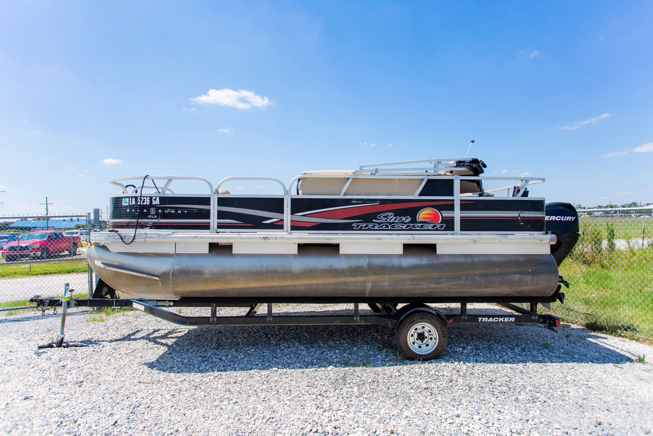 """THE BASS BUGGY"" - This 18 ft. boat holds a maximum of 8 passengers and is great for cruising the rivers and accessing some of the area's great fishing holes."