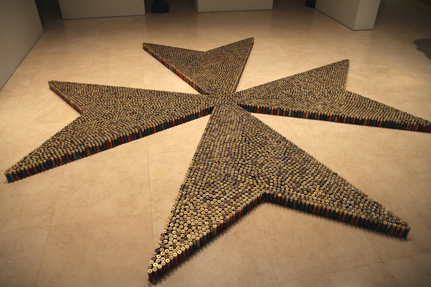 9,000 spent shotgun cartridges were used to create a large-scale installation of the 'Maltese Cross'.