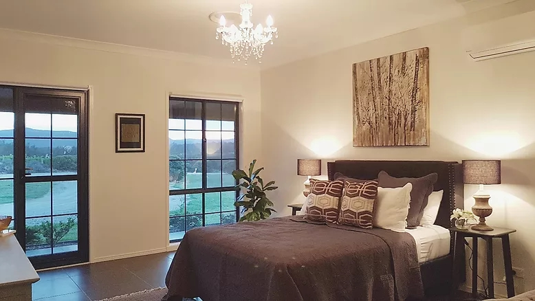 Absolute Luxury - An absolute haven of comfort and elegance, luxuriously decorated large air-conditioned room with spectacular views of the Brokenback mountain ranges and our vineyard , covered patio and outdoor setting.CHECKOUT YOUR LUXURY STAY →