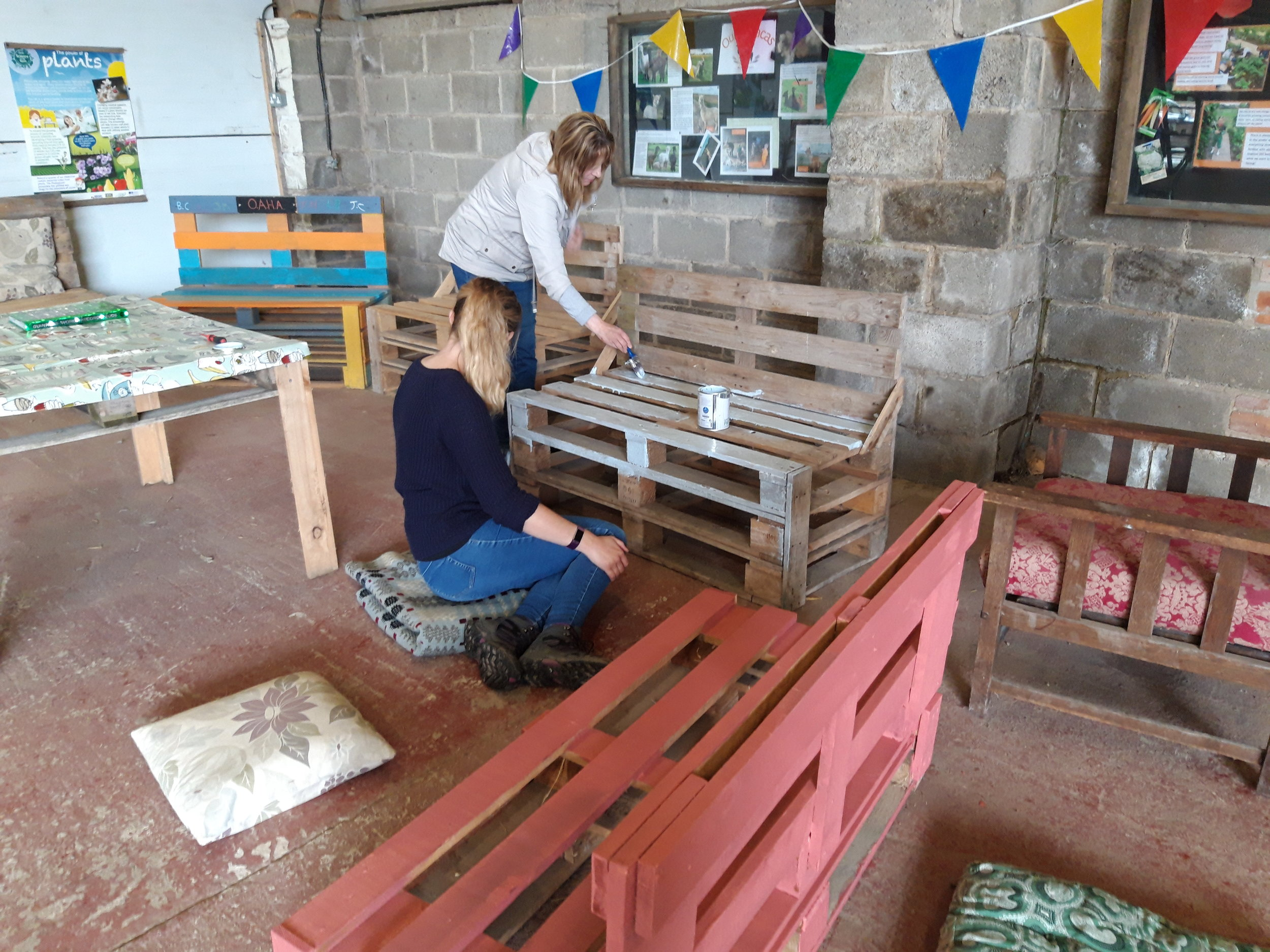 Painting benches to brighten up the farm
