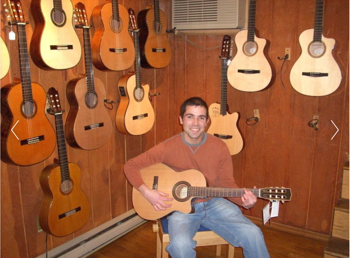 Darian Rivera with guitar.PNG