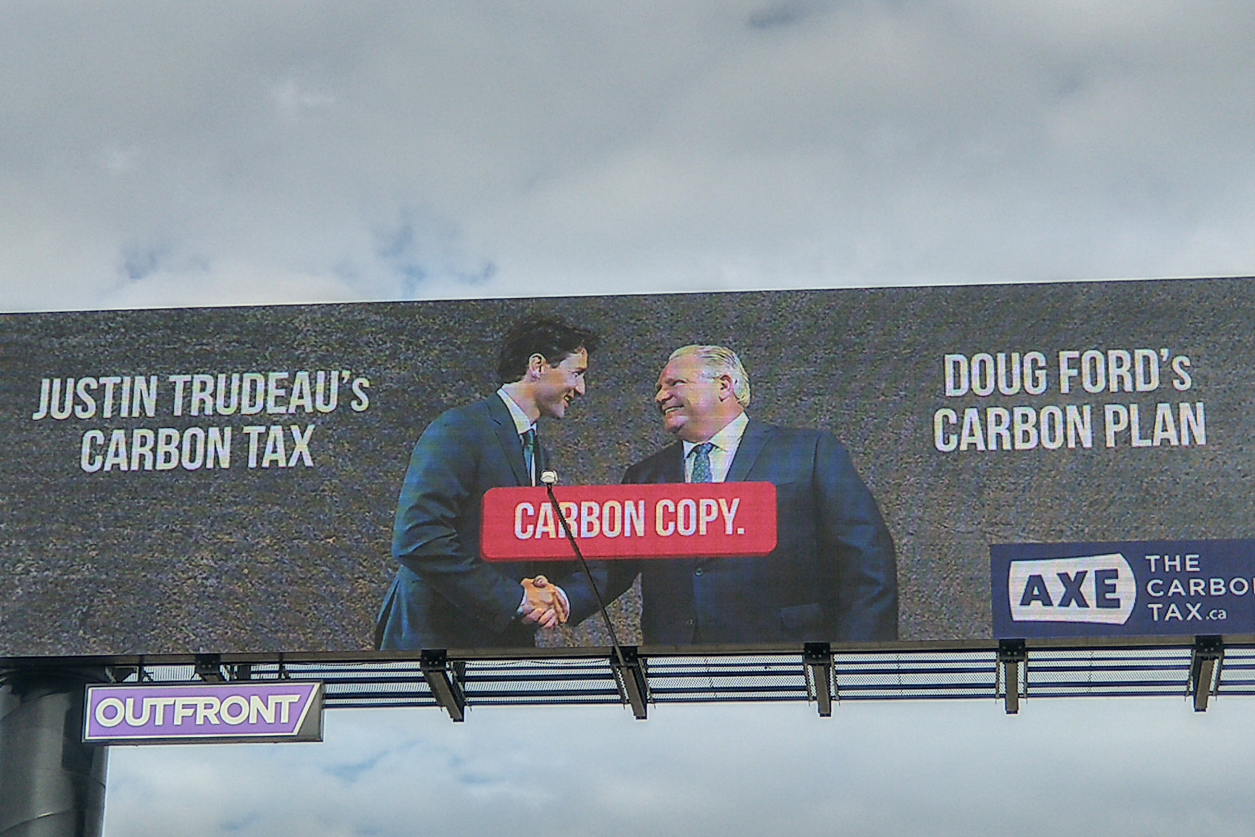 Catch the AxeTheCarbonTax.ca billboard on the Gardner at Dufferin street facing east.