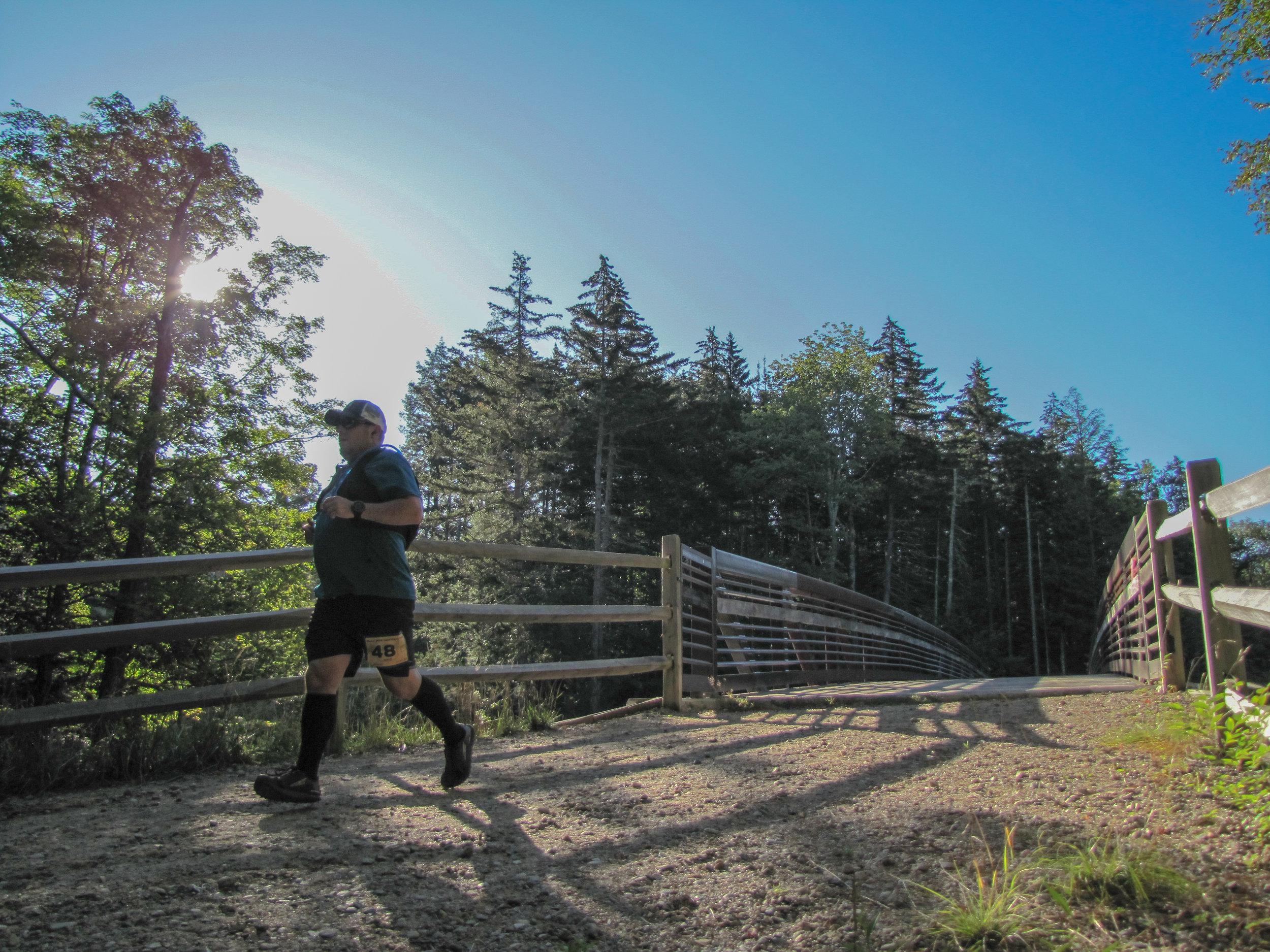 A more perfect day couldn't have been dreamed of for the revamp of the Black Bear Half Marathon, held Saturday, August 31st in Waterville Valley. Having been last run primarily on road in 2016, the race is back in name and evolved in form. This year's full fledged Black Bear Trail Half Marathon delivered 800 feet of elevation gain over 13.5 miles of smooth forest road, technical single track, and just enough mud to satisfy.
