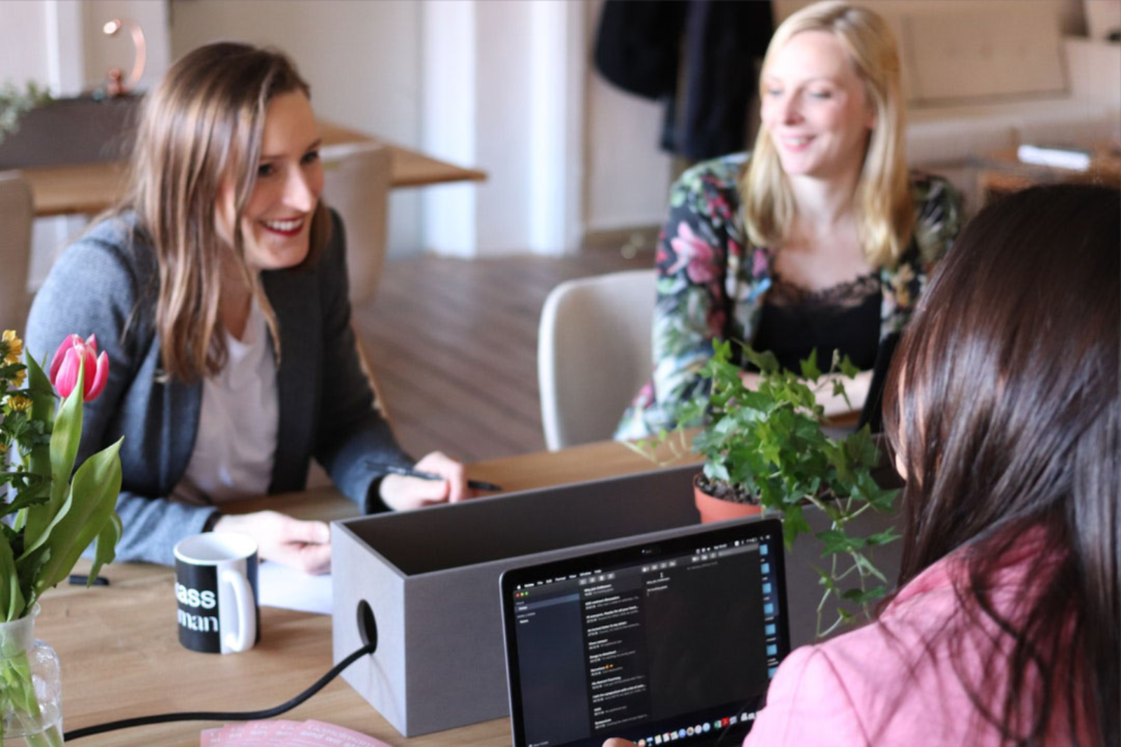 image of three women talking around computers.png