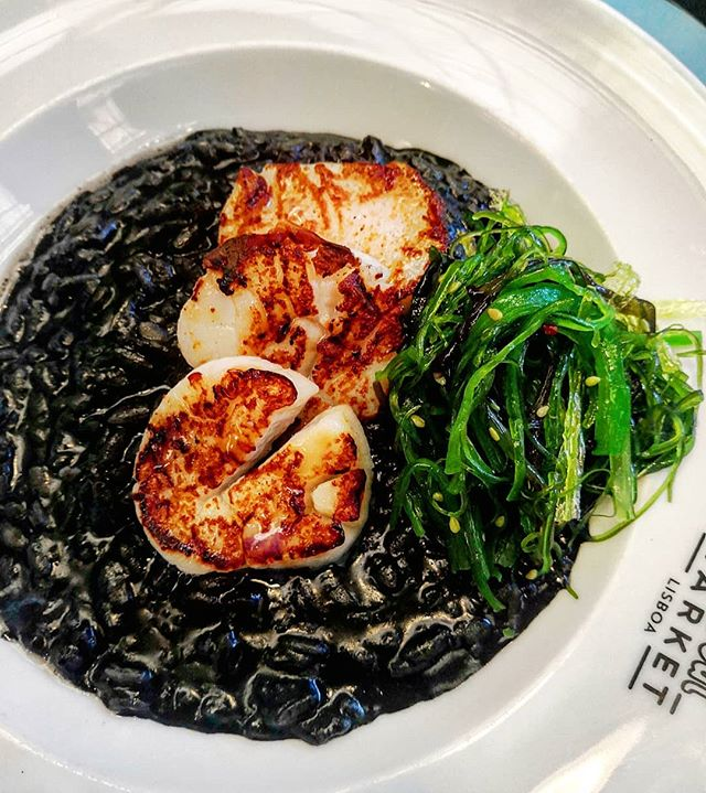 Squid ink risotto with seared scollops & wakame seaweed.  Really interesting fusion of Portuguese and Japanese flavours.  #foodie  #foodblogger #instafood #instafoodie #instafoodies #instagood #gastronomy #foodporn  #photooftheday  #foodiesofinstagram #risotto #lisbon #portugal🇵🇹