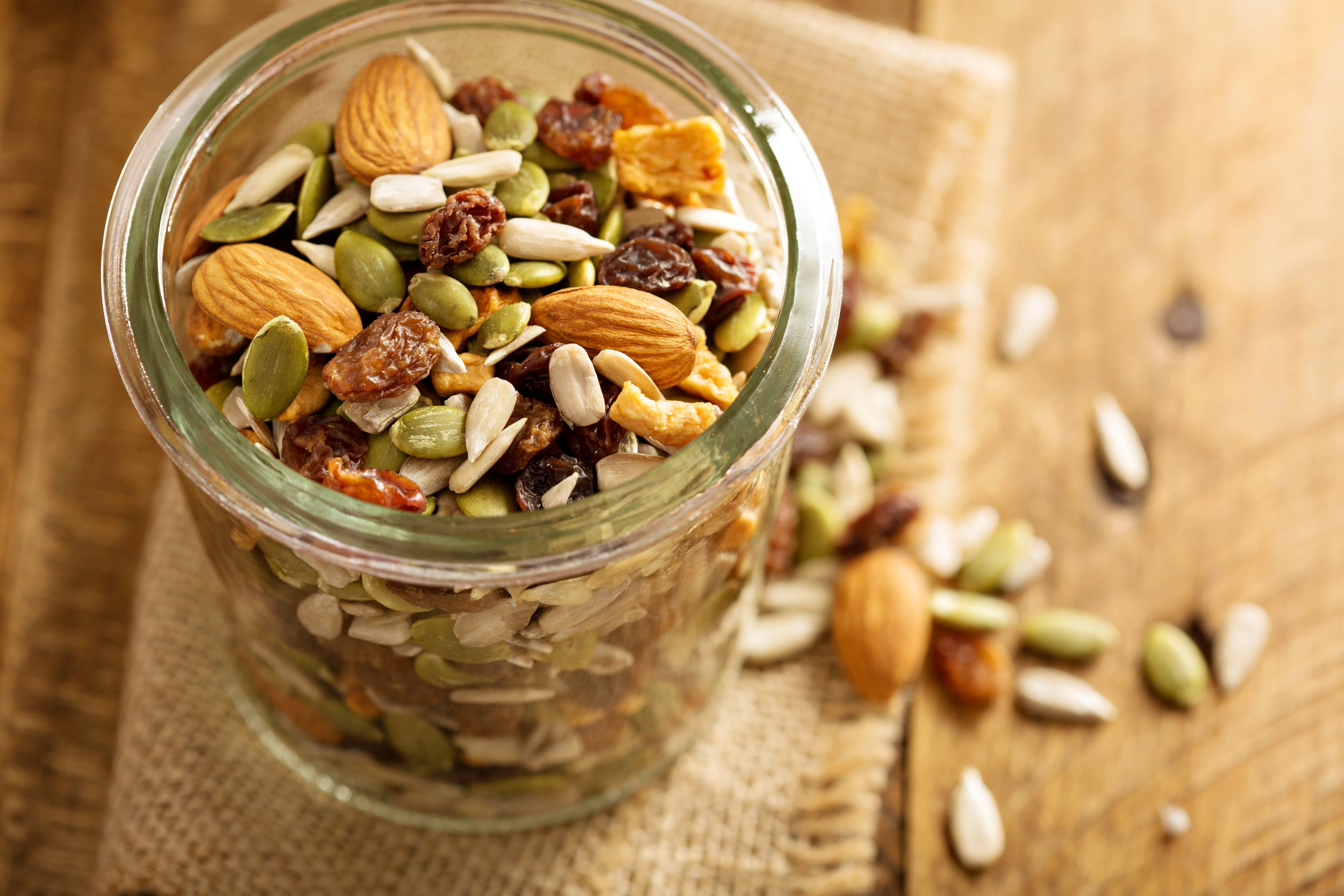 Eatcrispyfoods.  Apples, celery, carrots, snap peas, nuts, veggie chips, popcorn, roasted chickpeas, trail mix, whatever you may like. The more you chew, the slower you eat, and the more time your body has to record the richness of your foods.