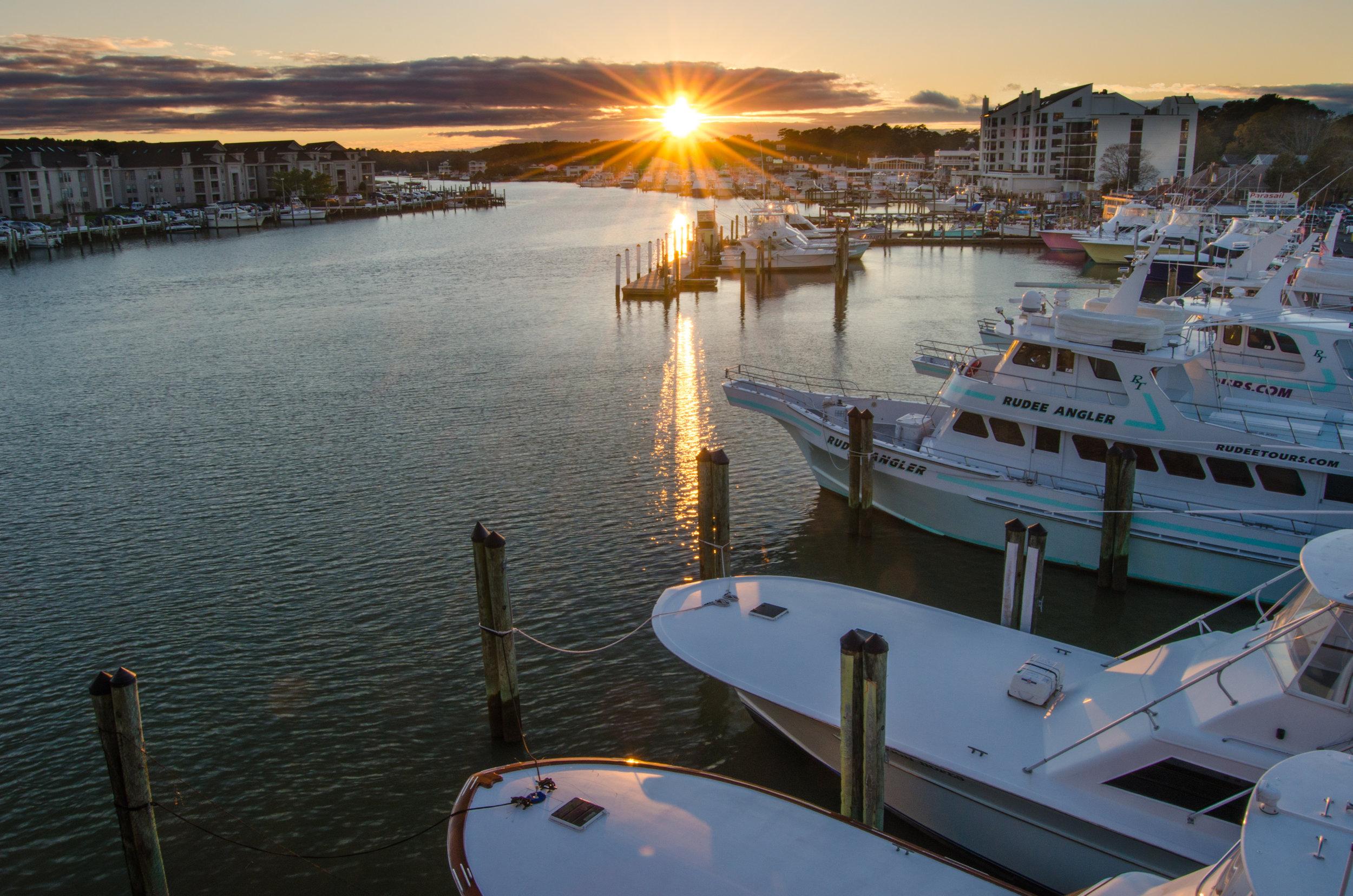 Sunset over boats at Rudee Inlet Marina in Virginia Beach, Virginia  - sun flare.jpg
