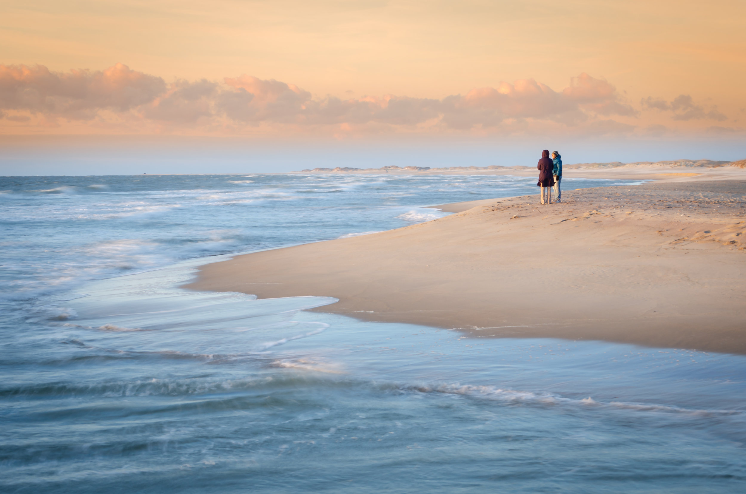 couple on beach-sunrise-cape hatteras-obx-outer banks-north carolina.jpg