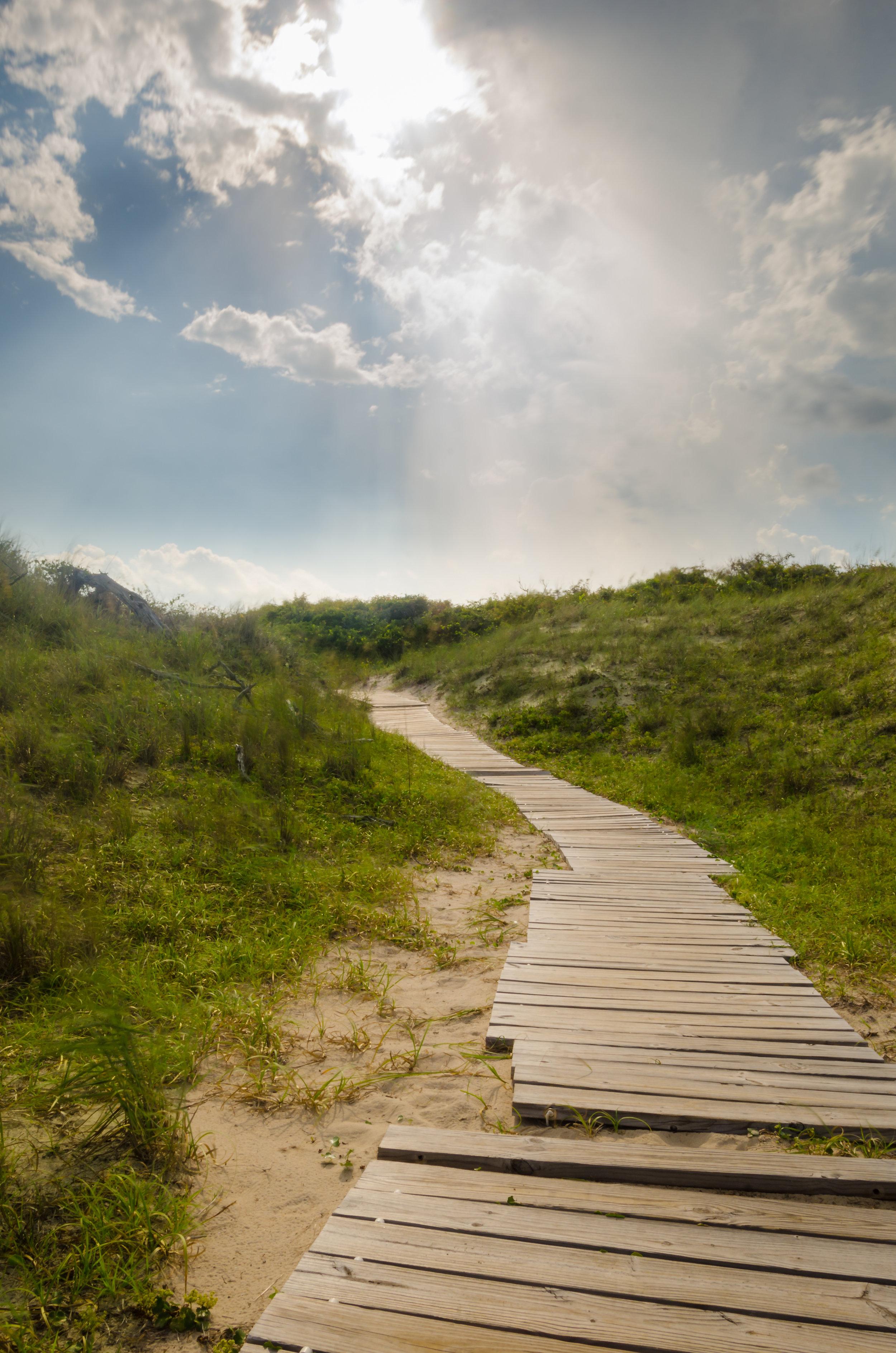 Heaven rays shine down upon a beach path in Virginia Beach, Virginia.jpg