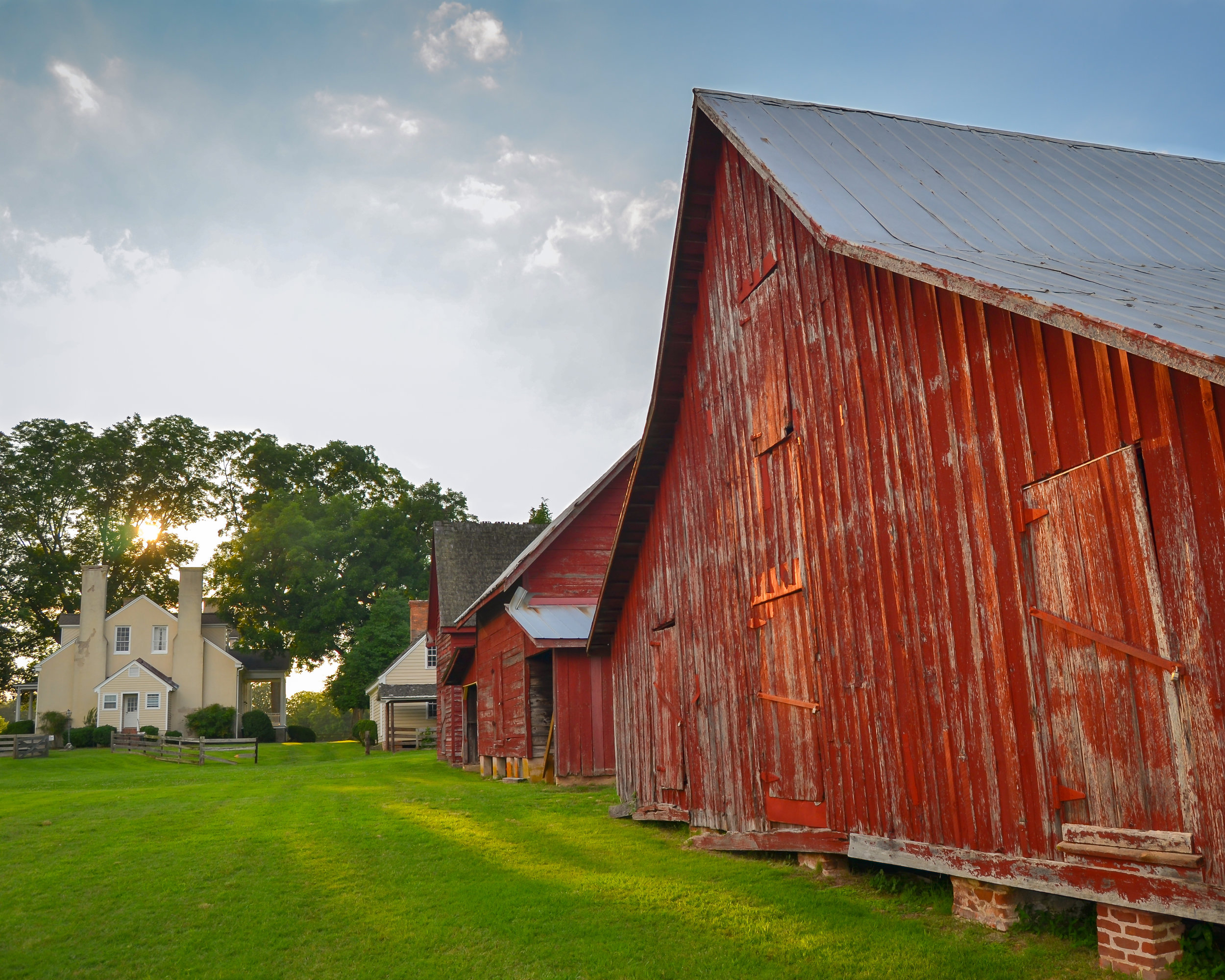Historic old red barns and a house in afternoon sunlight at Windsor Castle Park in Smithfield,Virginia-2.jpg