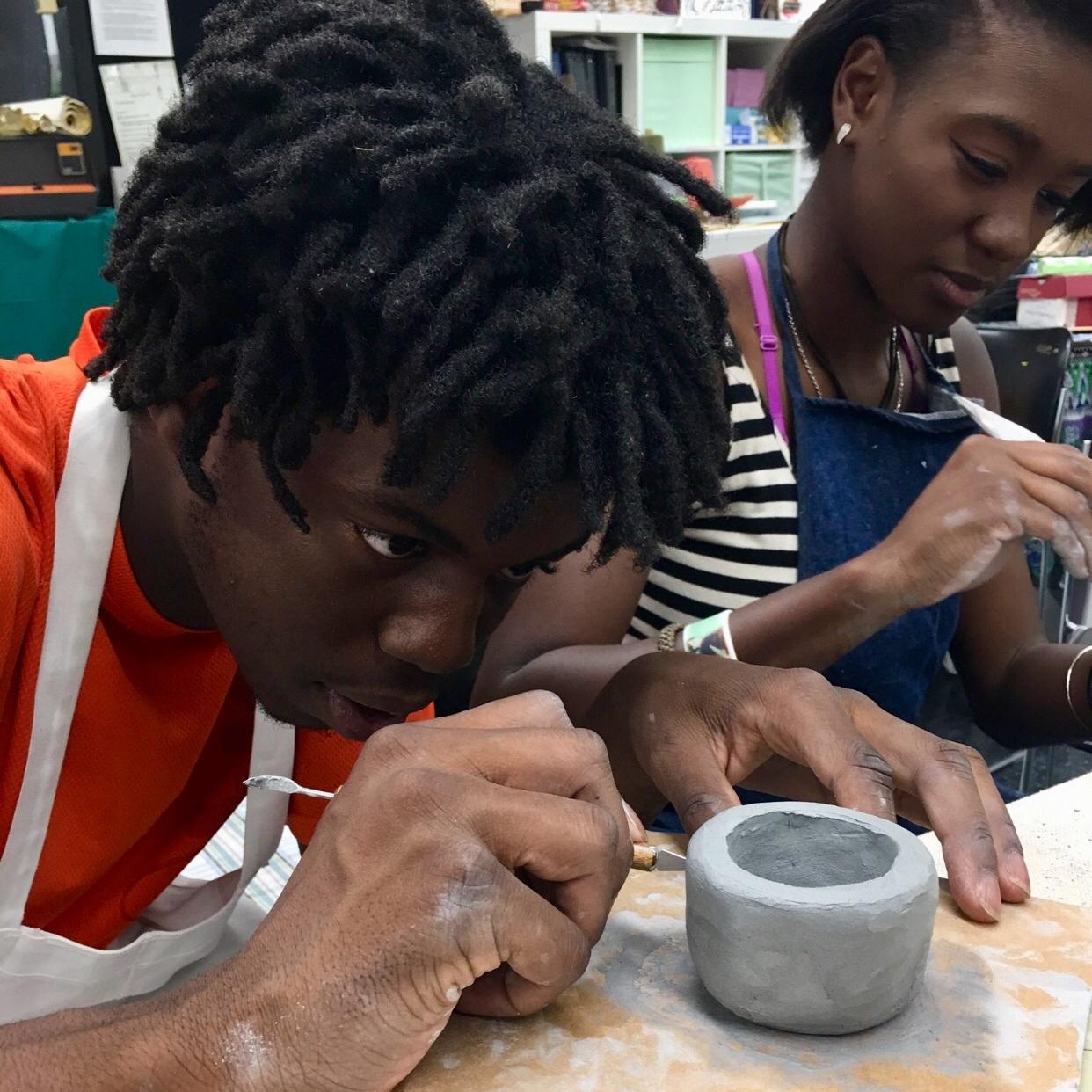 kid+making+pottery.jpg